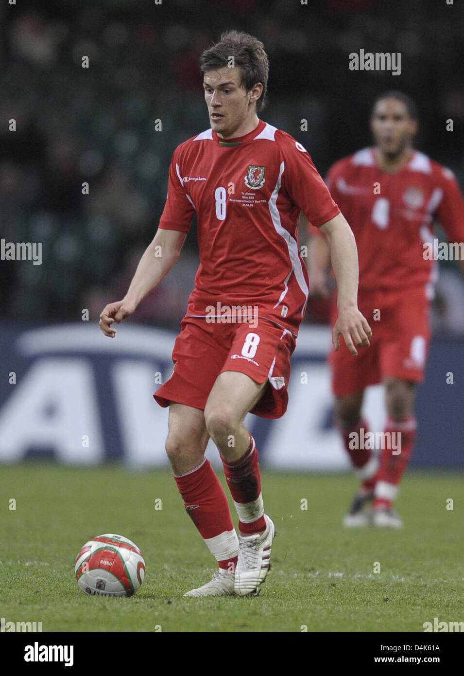 Welsh international Aaron Ramsey seen in action during the FIFA 2010 World Cup qualifier Wales vs Germany in Cardiff, Stock Photo
