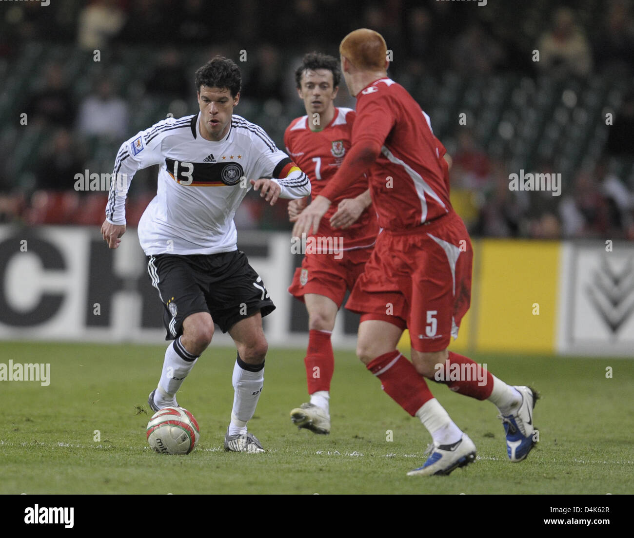 Germany?s skipper Michael Ballack leads the ball during the FIFA 2010 World Cup qualifier Wales vs Germany in Cardiff, Stock Photo