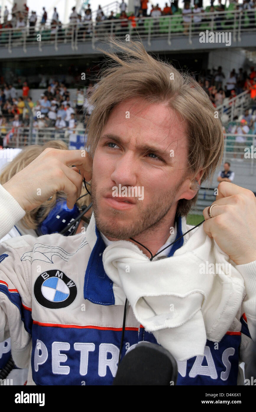 German Formula One driver Nick Heidfeld of BMW Sauber grimaces in the grid before the start of the  the Malaysian Stock Photo