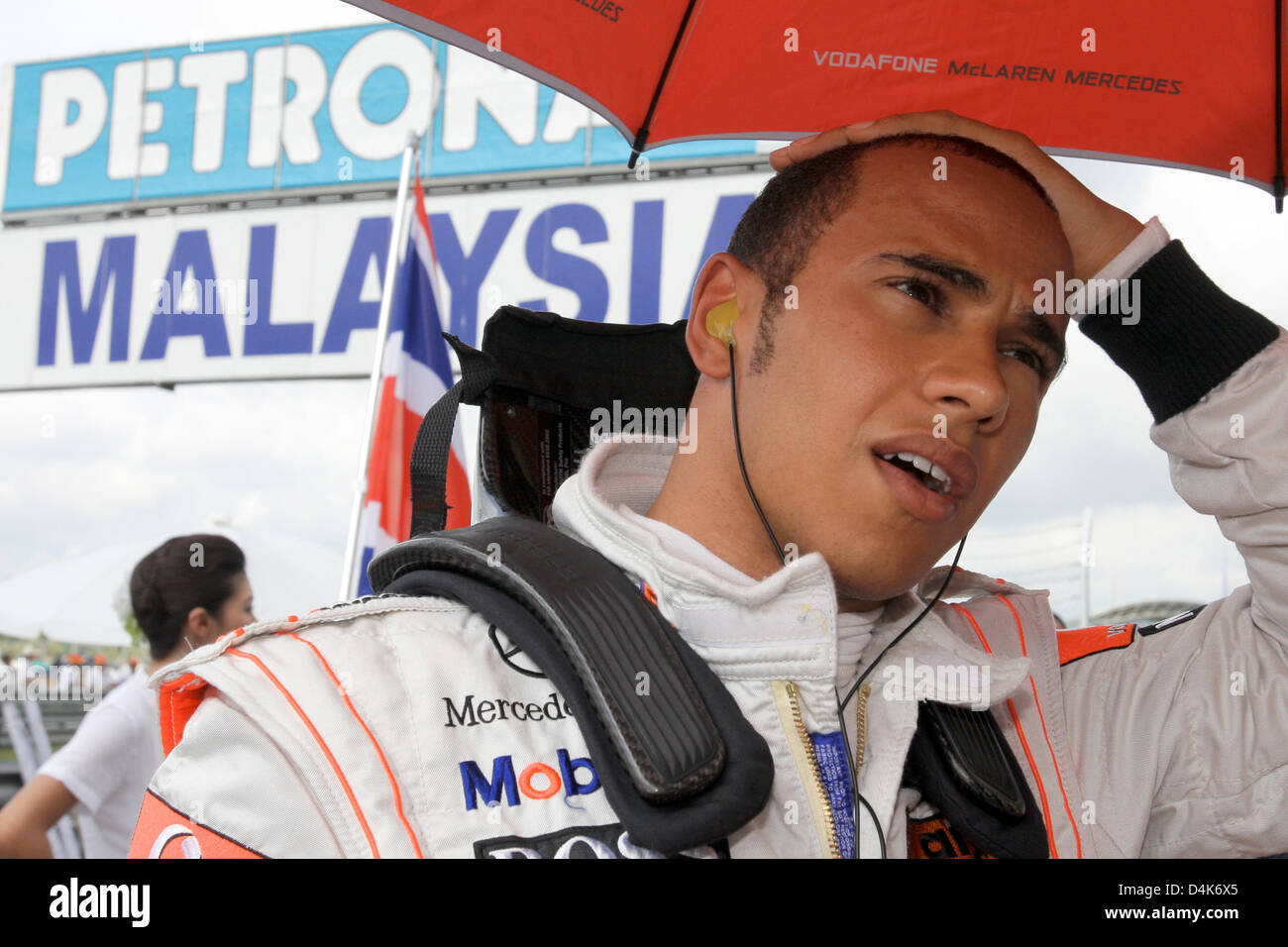 British Formula One driver Lewis Hamilton of McLaren Mercedes gestures in the grid before the start of the Malaysian Stock Photo