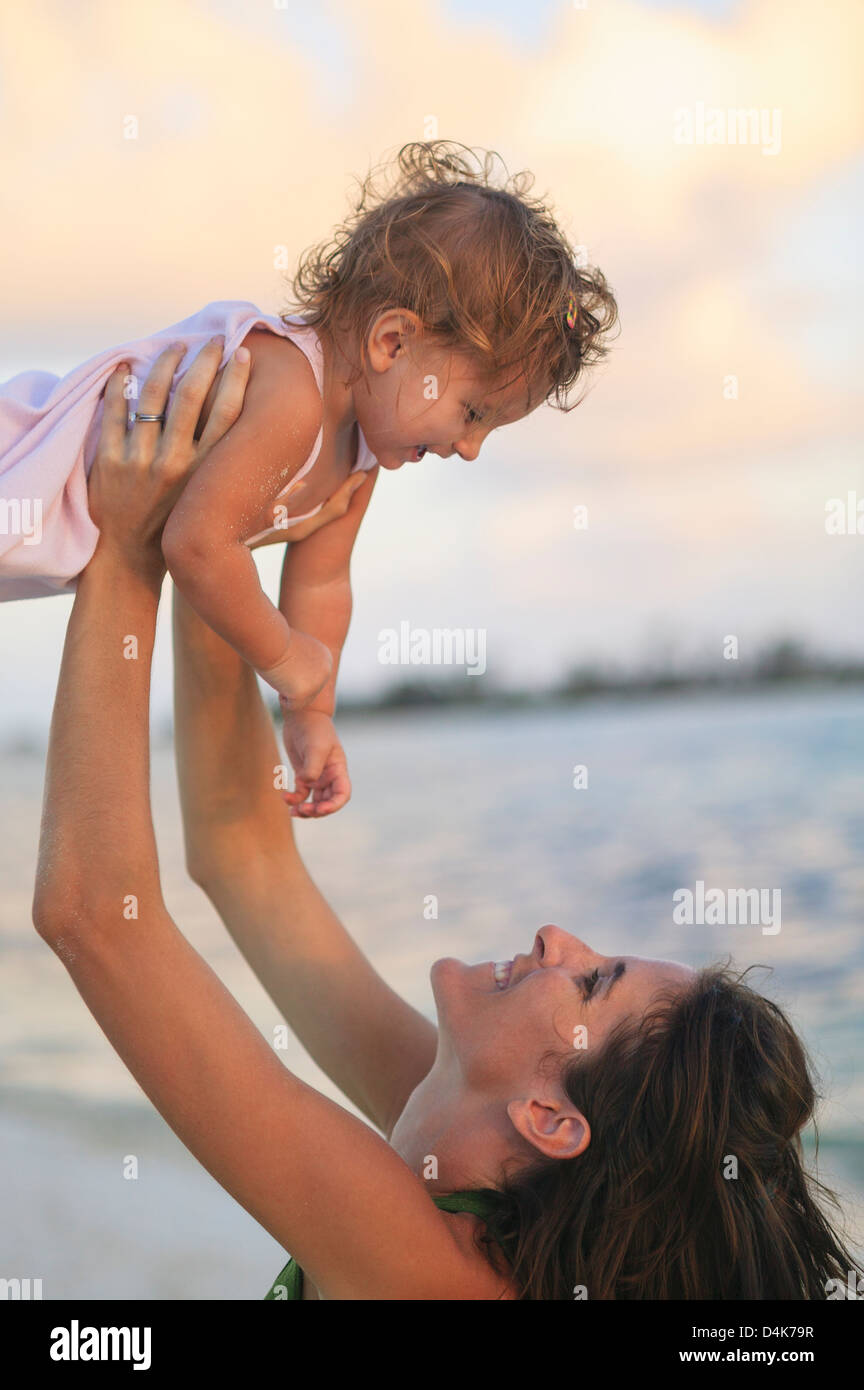 Mother and toddler daughter on beach Stock Photo