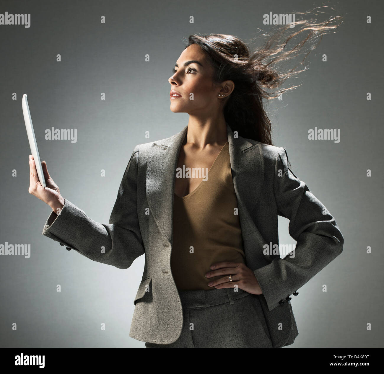 Businesswoman holding tablet computer - Stock Image