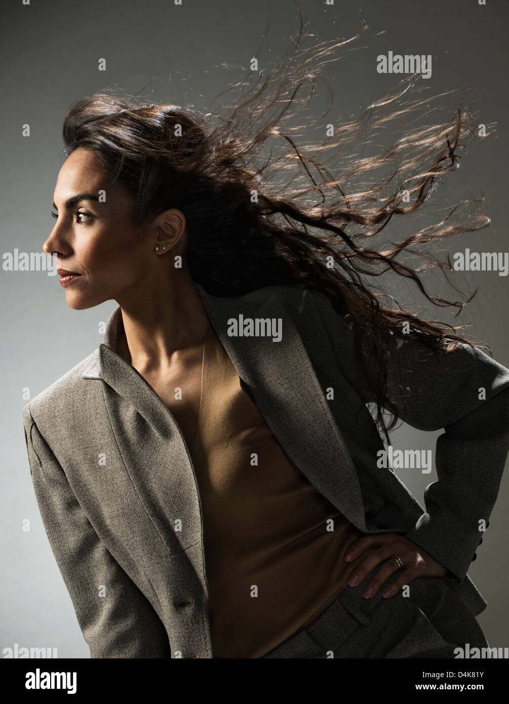 Businesswoman standing with hand on hip - Stock Image