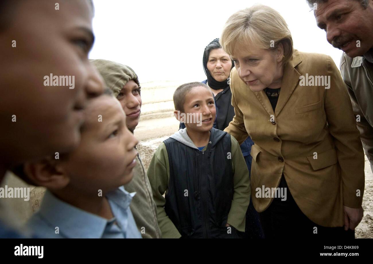 German Chancellor Angela Merkel 2 R Talks With Children During Her Stock Photo Alamy