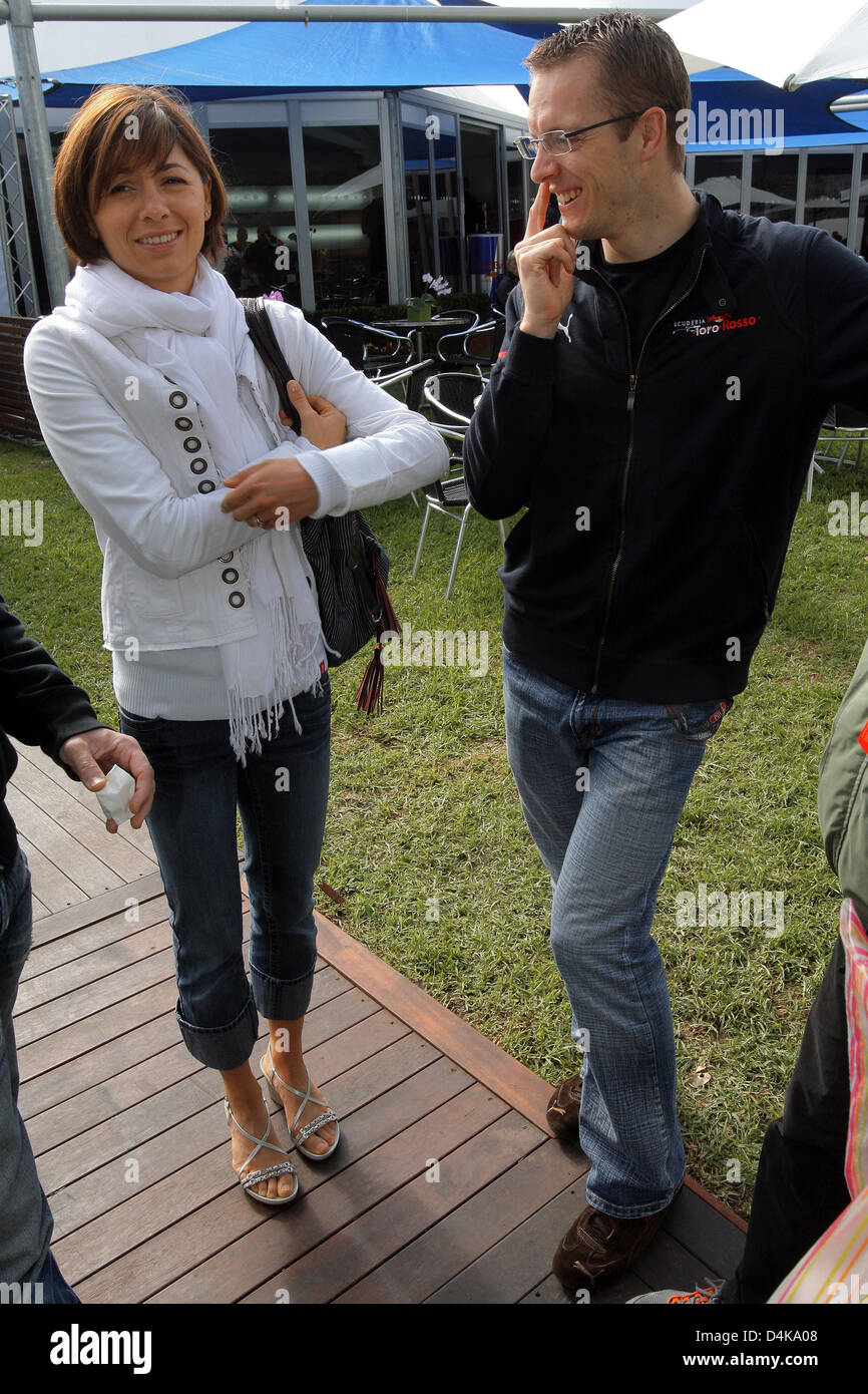 French Formula One driver Sebastien Bourdais of Toro Rosso and his wife Claire pictured prior to the Formula One Stock Photo