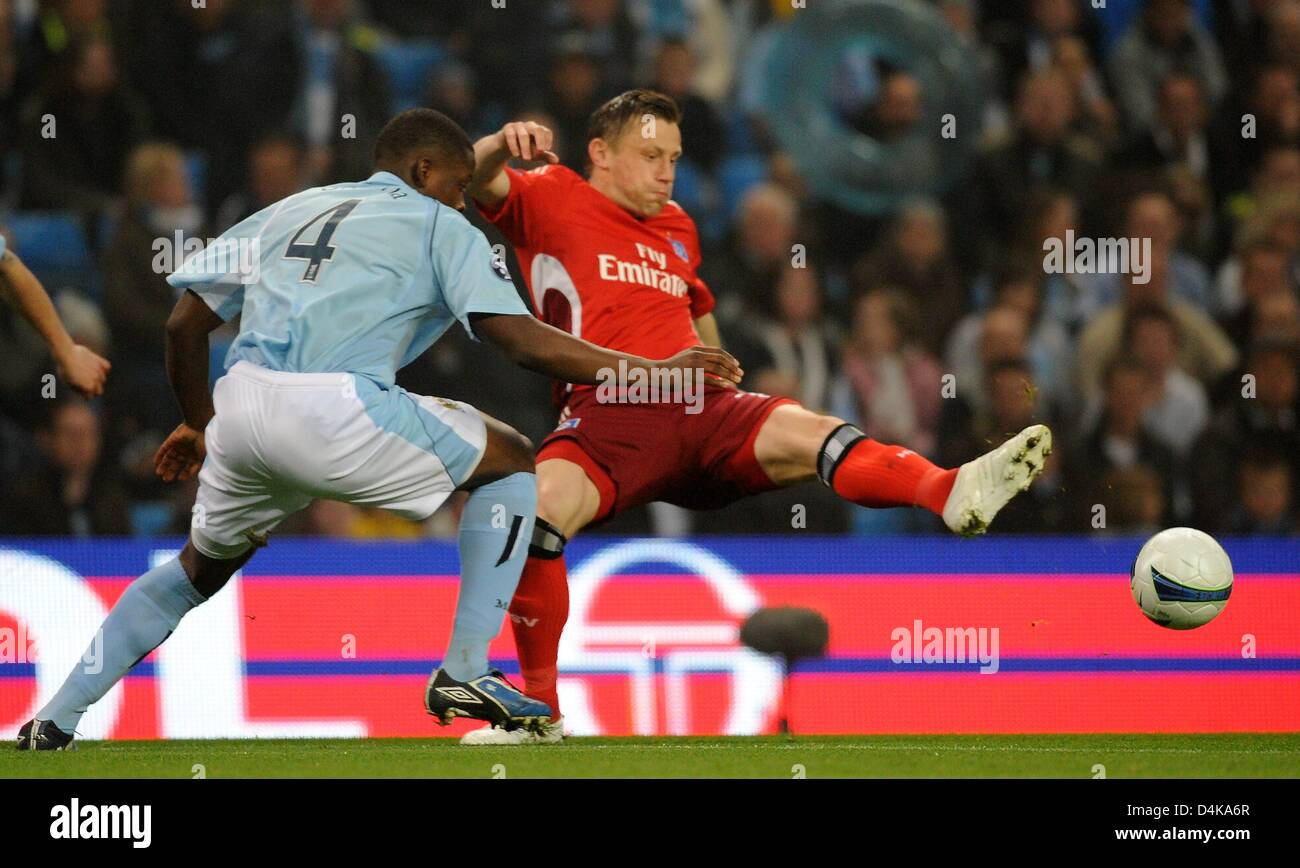Manchester City?s Nedum Onuoha vies for the ball with Hamburg?s Ivica Olic (R) during the UEFA Cup quarter finals Stock Photo
