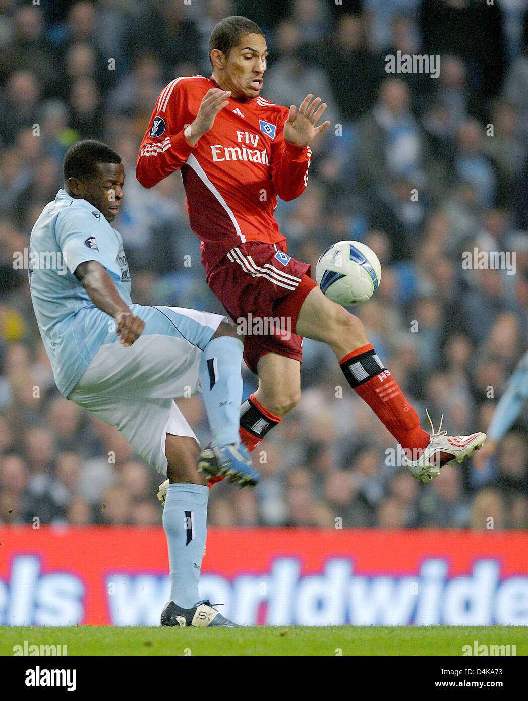 Manchester City?s Nedum Onuoha vies for the ball with Hamburg?s Jose Paolo Guerrero (R) during the UEFA Cup quarter Stock Photo