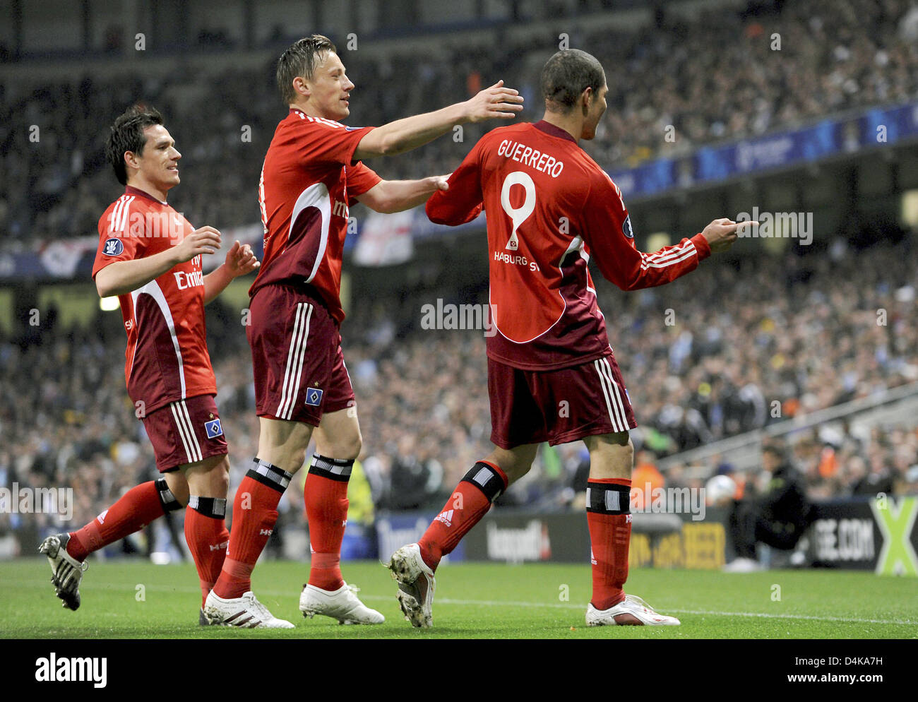 Hamburg?s Jose Paolo Guerrero (R) cheers with his team mates Ivica Olic (C) and Piotr Trochowski after scoring the Stock Photo