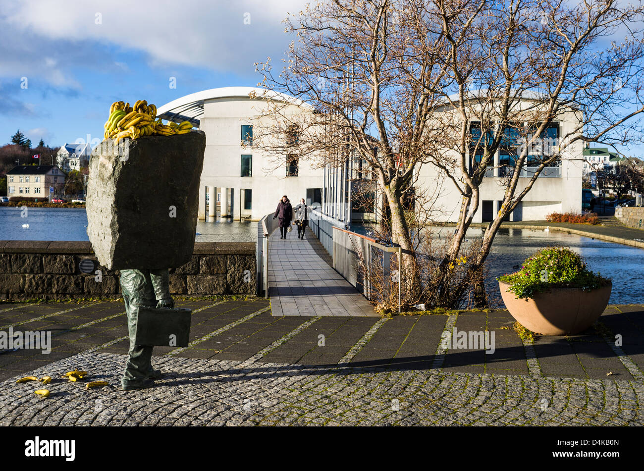 A statue by Magnús Tómasson located by Reykjavik City Hall with its head covered for some obscure reason - Stock Image