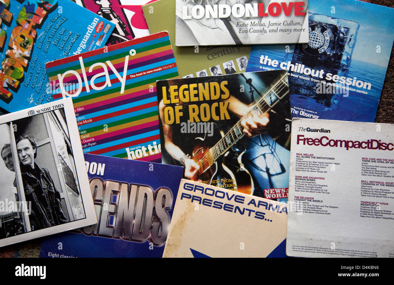 Free compact discs given away with newspapers, London - Stock Image
