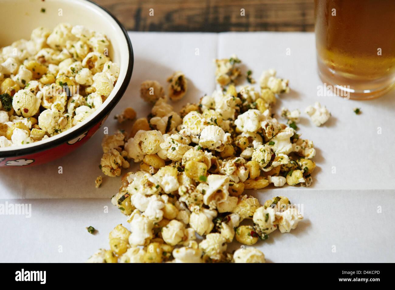 Popcorn on napkin on table - Stock Image
