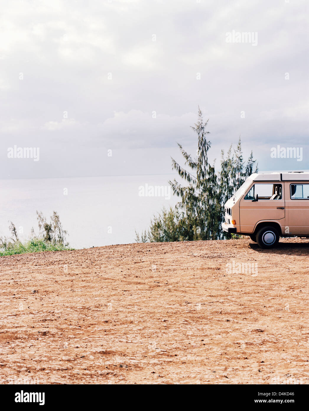 Van parked on sandy cliff - Stock Image