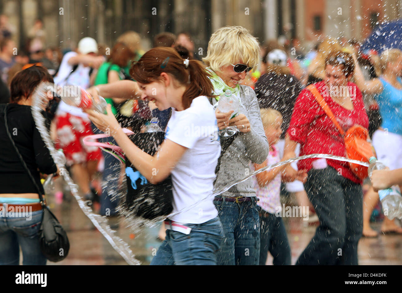 attractive price fashion styles authorized site Participants in a water fight ?flashmob? enjoy themselves on ...