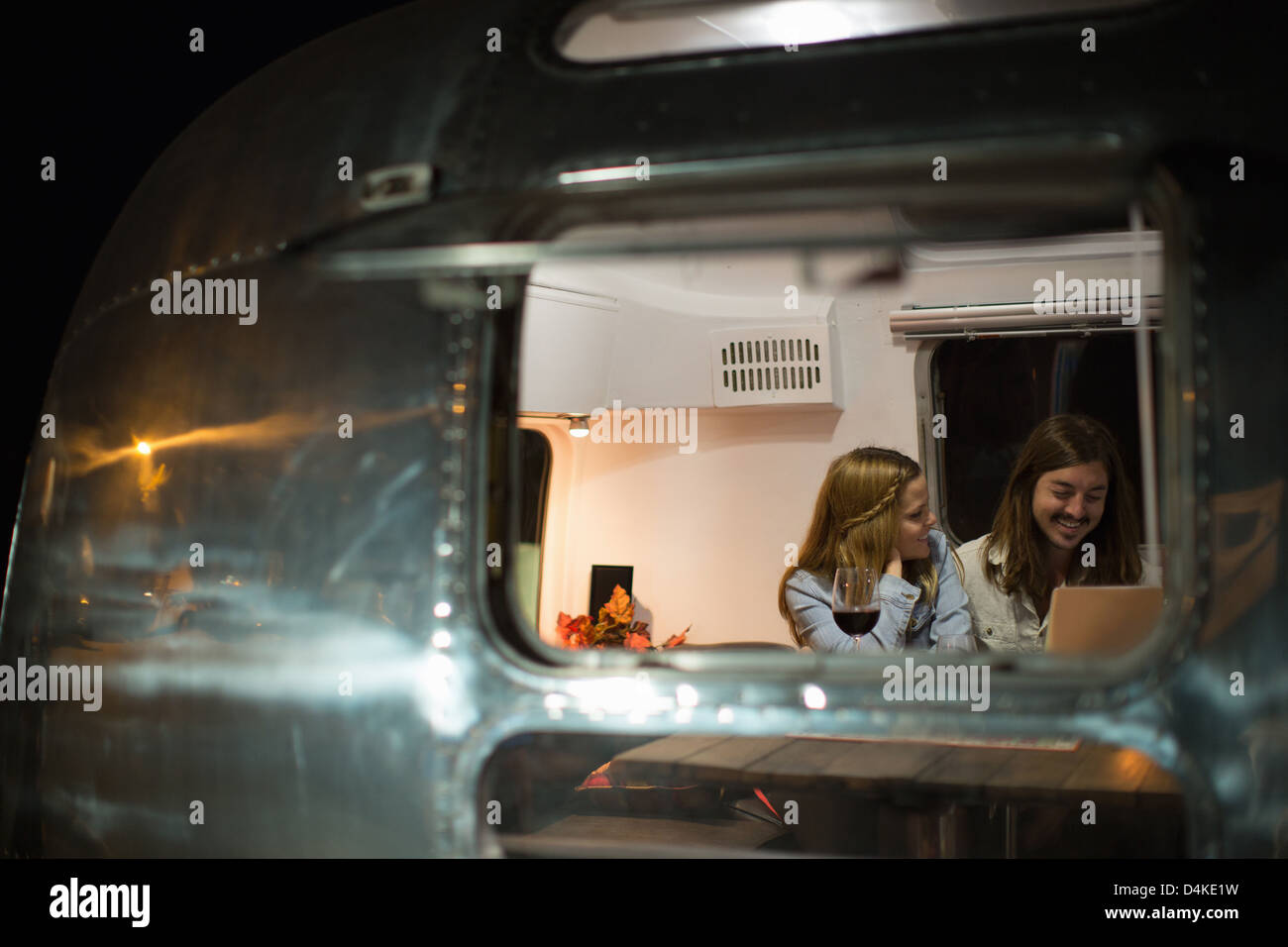 Couple relaxing together in trailer - Stock Image