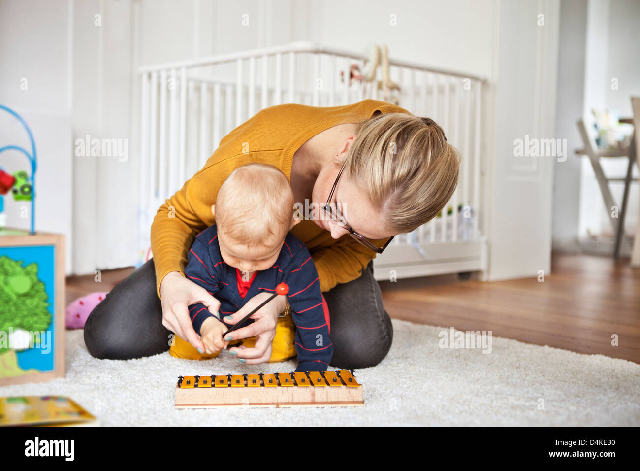 Mother and baby boy playing together - Stock Image