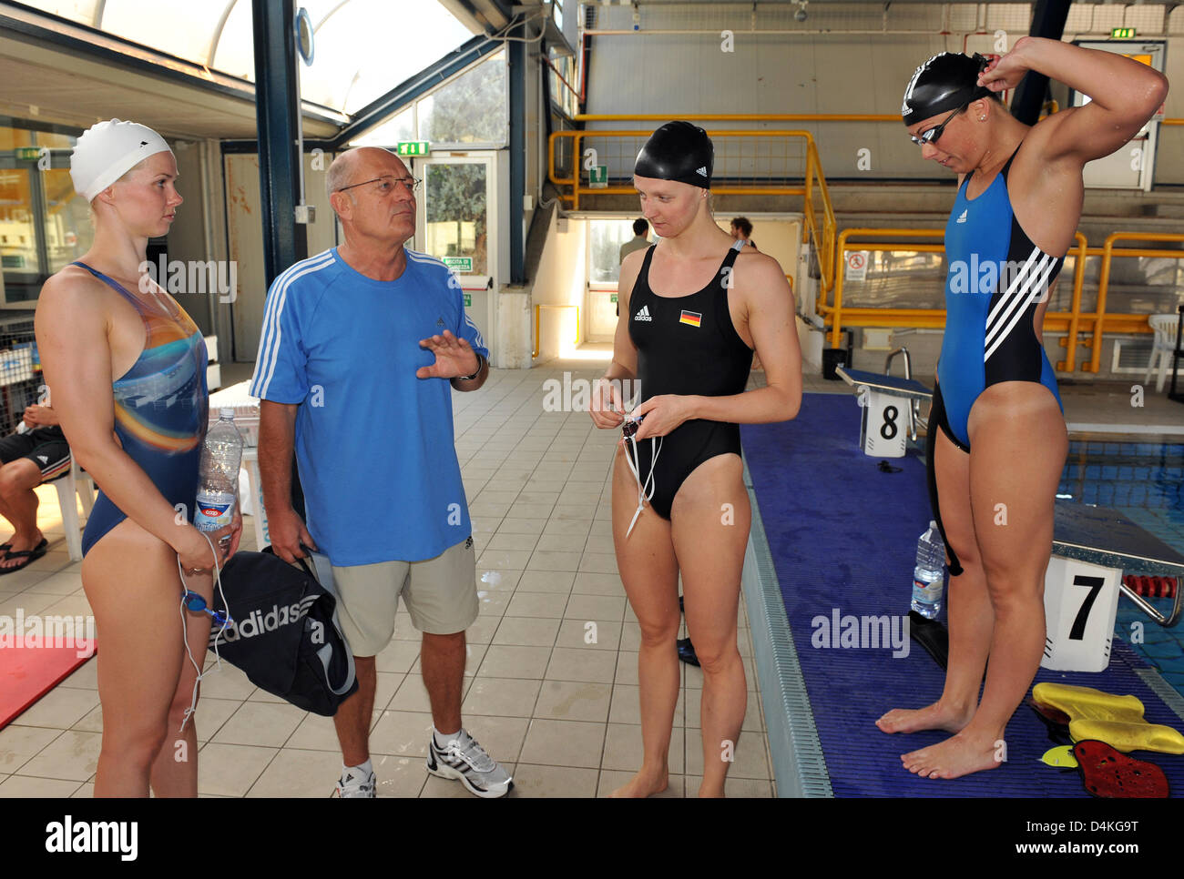 German Swimmers Britta Steffen L R Petra Dallmann And Daniela Samulski Talk To Coach Norbert Warnatzsch In The Training Camp Of The German Swimming