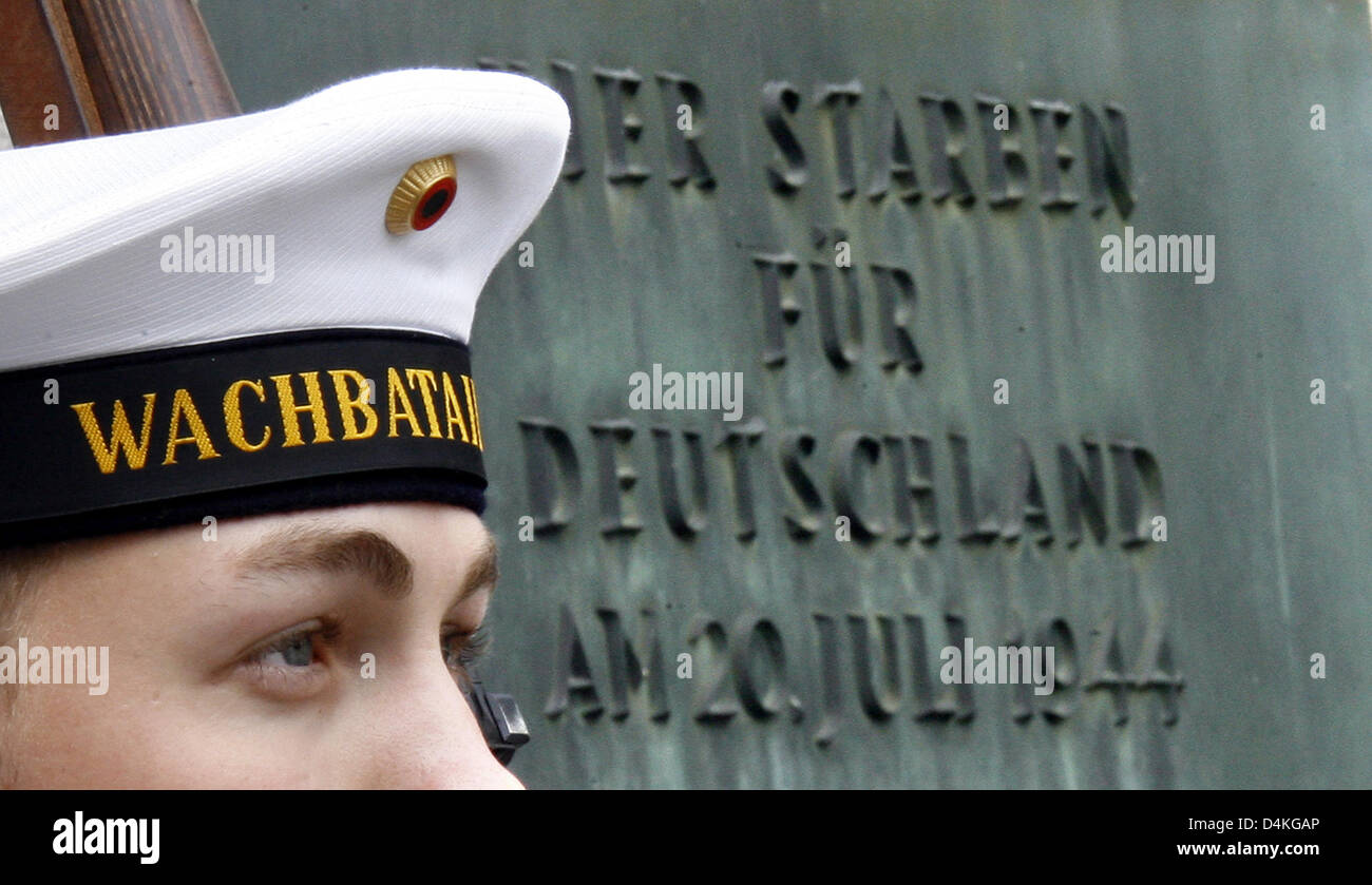 A Navy soldier of the Bundeswehr guard battalion stands next to the memorial plaque for the attempted assasination - Stock Image