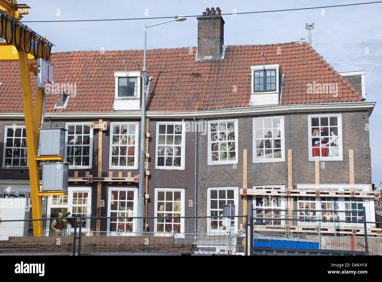 Evacuated and fenced off houses are pictured next to an underground building site in the city centre of Amsterdam, Stock Photo