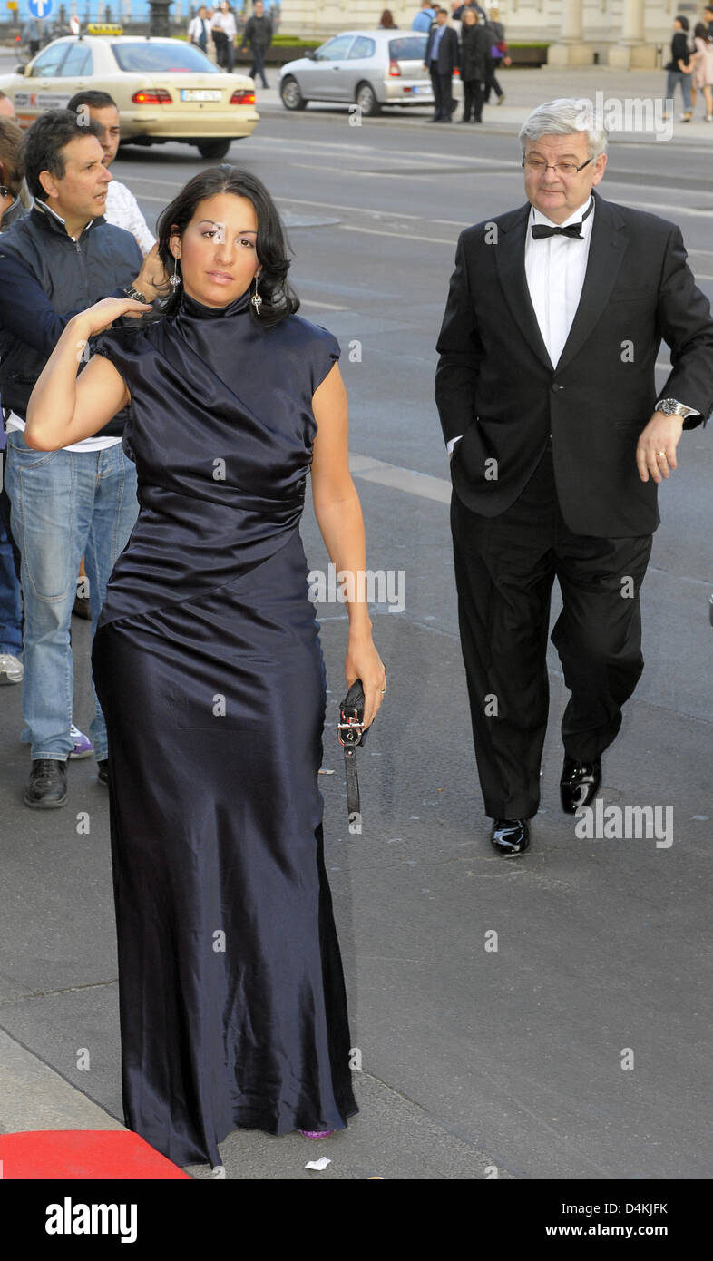 Former German Foreign Minister Joschka Fischer (R) and his wife, producer Minu Barati-Fischer arrive at the German - Stock Image