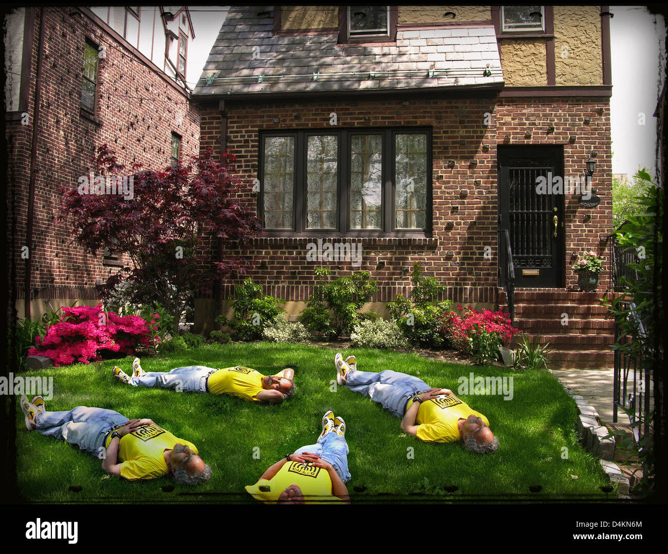 Same person lying in 4 different positions in a yard in front of a Tudor style house in New York City - Stock Image