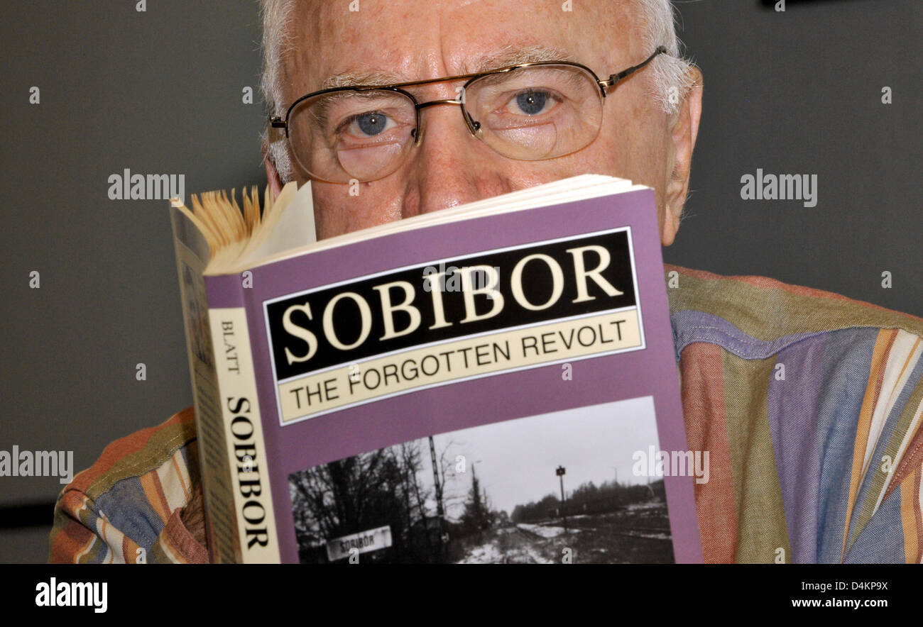 Thomas Blatt, likely to be the only survivor of extermination camp Sobibor, poses with his book ?Sobibor, The Forgotten - Stock Image