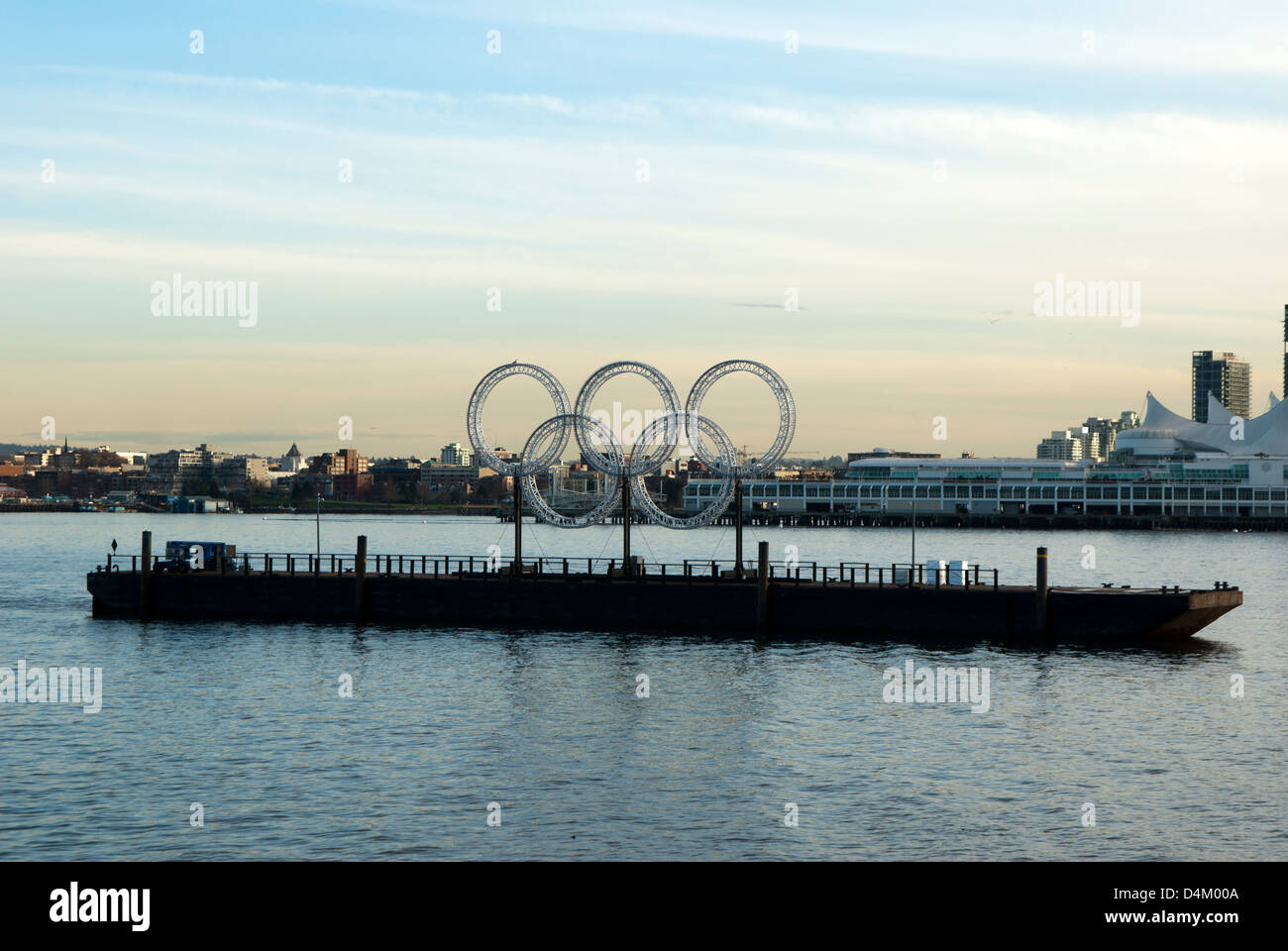Olympic rings  for 2010 winter olympics on a barge in the harbour at Vancouver, British Columbia, Canada Stock Photo