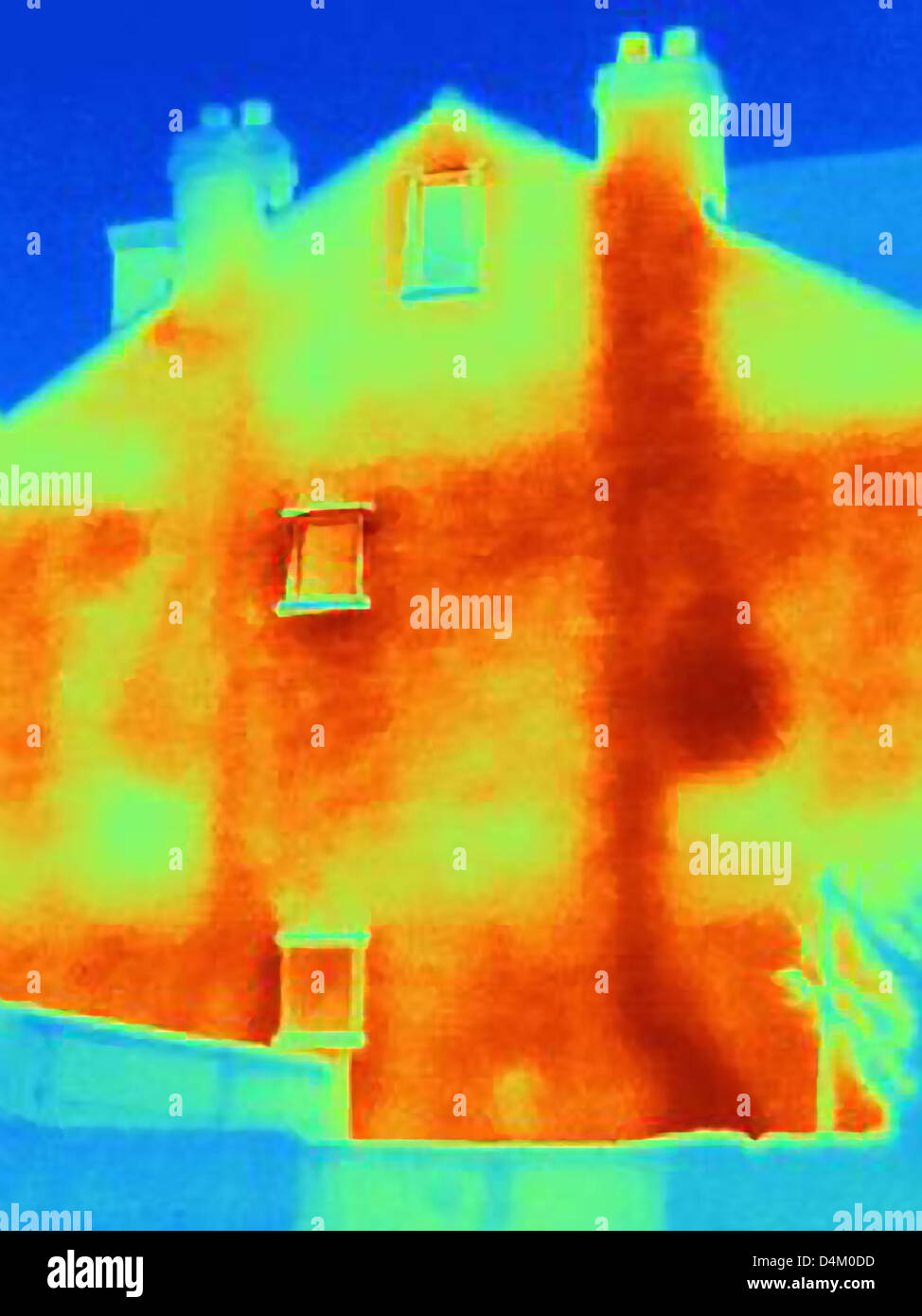 Thermal image of house and chimneys - Stock Image