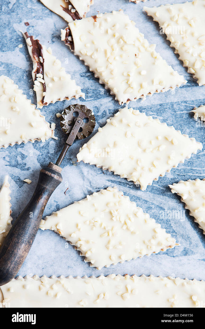 Cookie dough with decorative cutter - Stock Image