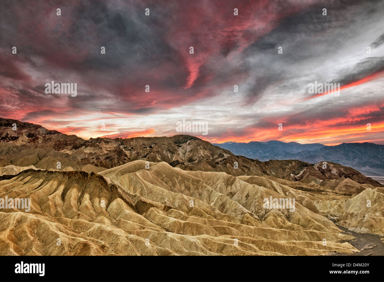 Spectacular sunset develops over Golden Canyon from Zabriskie Point and California's Death Valley National Park. - Stock Image