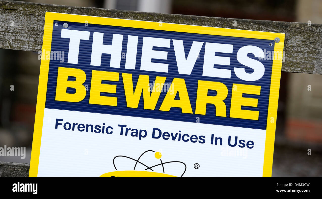 Thieves beware forensic trap devices in use sign - Stock Image