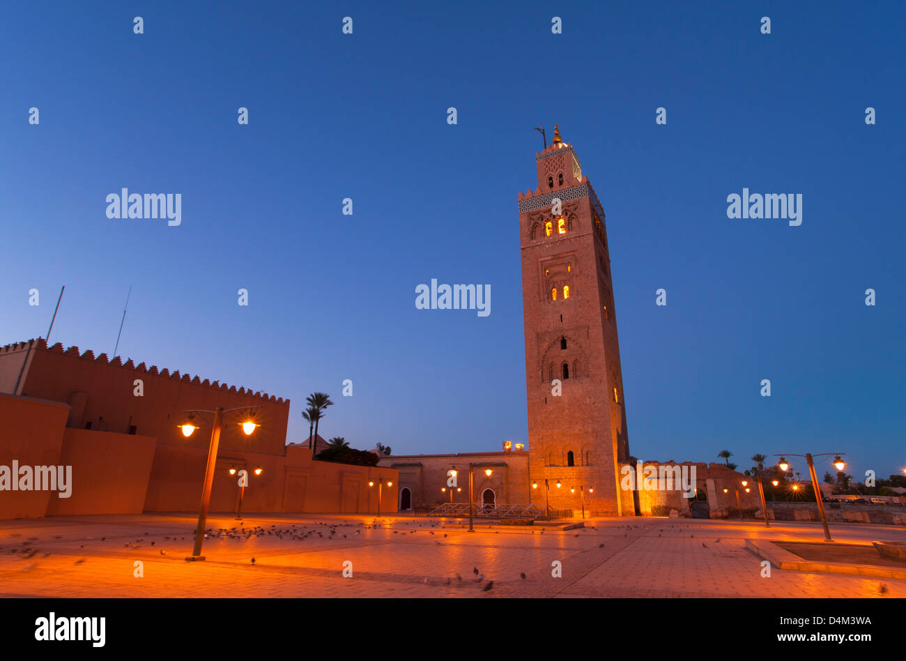 Tower overlooking courtyard at dusk - Stock Image