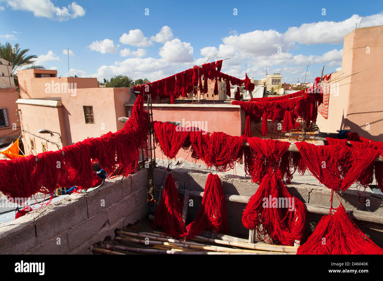 Dyed wool drying on lines - Stock Image