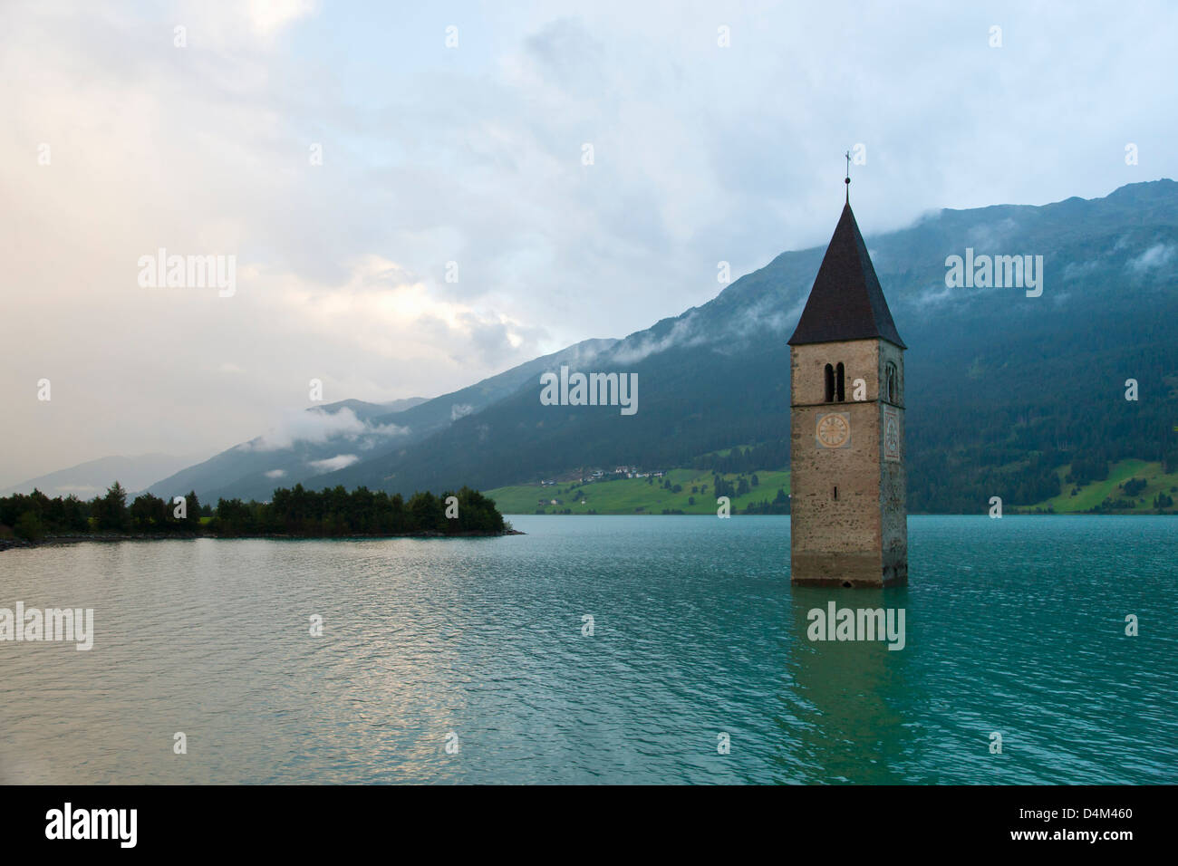 Clock tower submerged in rural lake - Stock Image
