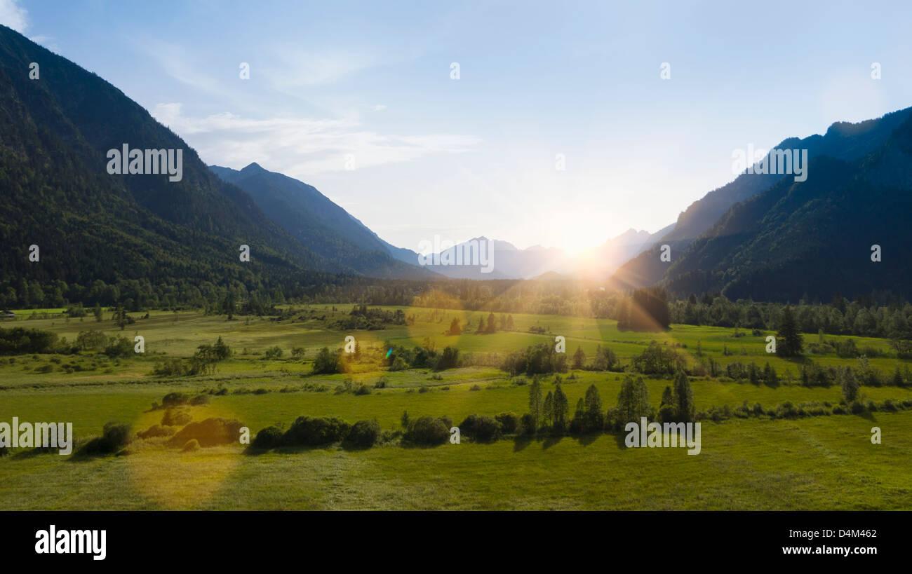 Sun shining over rural landscape - Stock Image
