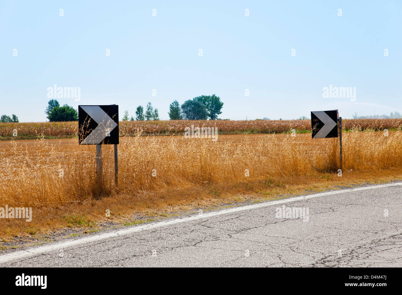 Traffic arrows on rural road - Stock Image