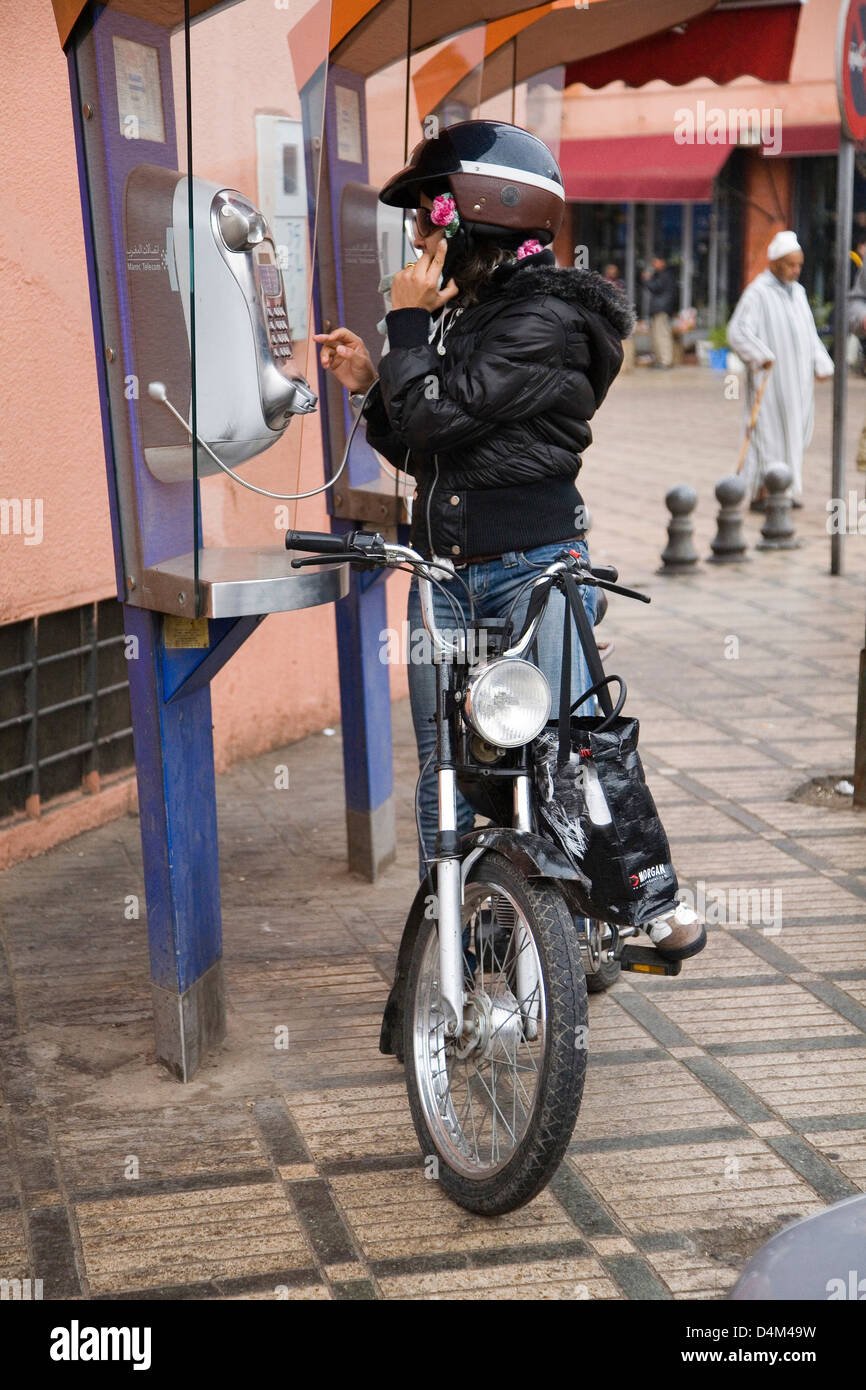 africa, morocco, marrakech, girl at the telephon box - Stock Image