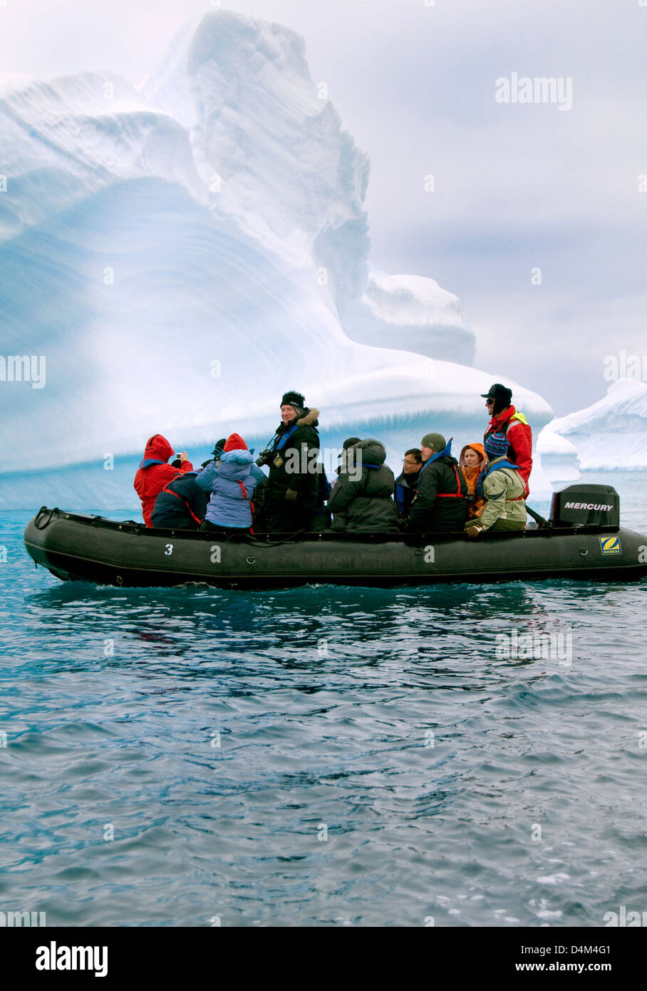 Tourists cruising among icebergs in Antarctica - Stock Image