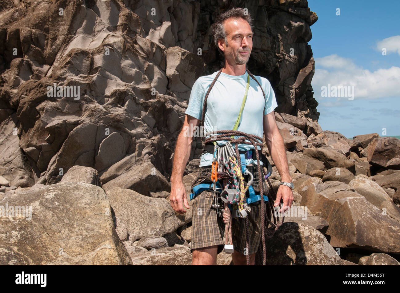 Rock climber wearing clips and ropes - Stock Image