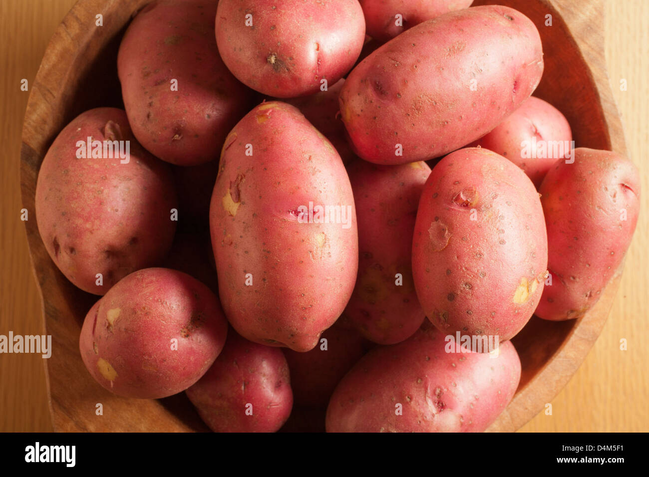 wooden bowl of red potatoes - Stock Image