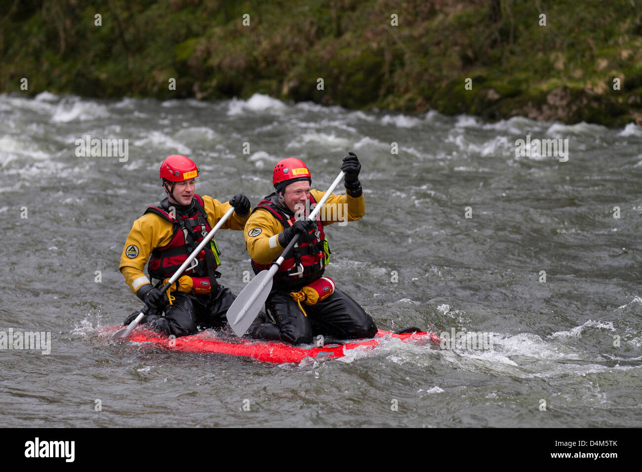 Swiftwater and Flood Rescue Technician course. Trainee Firemen at Devil's Bridge in Kirby Lonsdale, England Friday Stock Photo