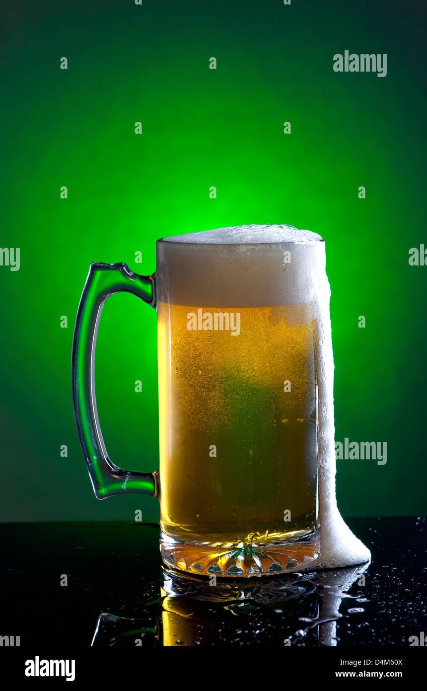 Foamy mug of beer. - Stock Image