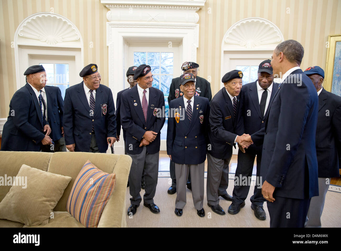 US President Barack Obama greets veterans of the 2nd Airborne Ranger Infantry Company in the Oval Office of the - Stock Image