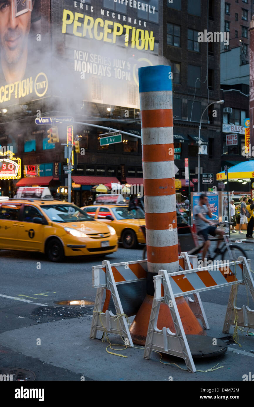 Steam vent in the street near Times Square, New York - Stock Image