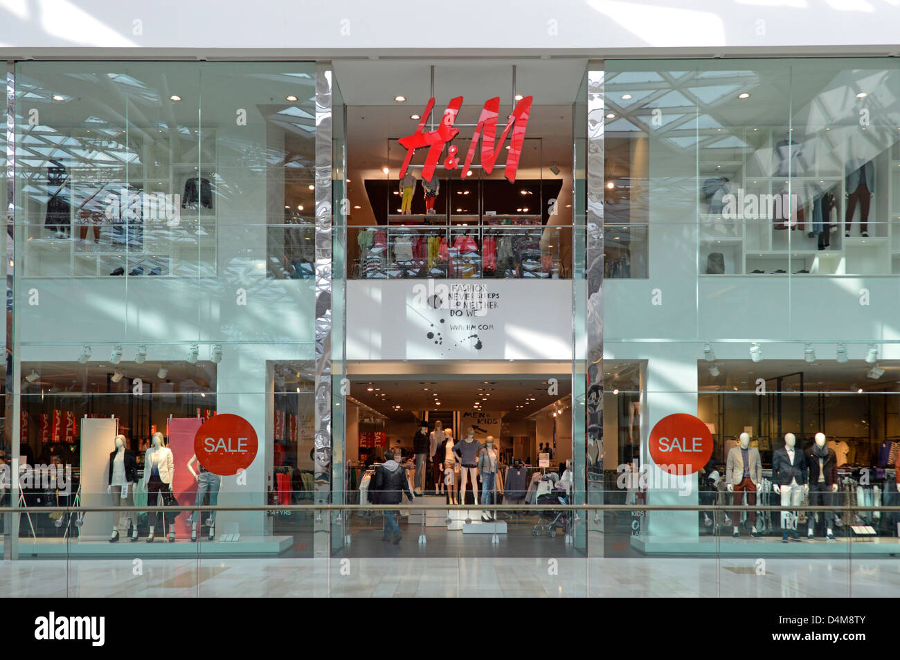 h m store with interior views through shop front window displays and stock photo 54535739 alamy. Black Bedroom Furniture Sets. Home Design Ideas