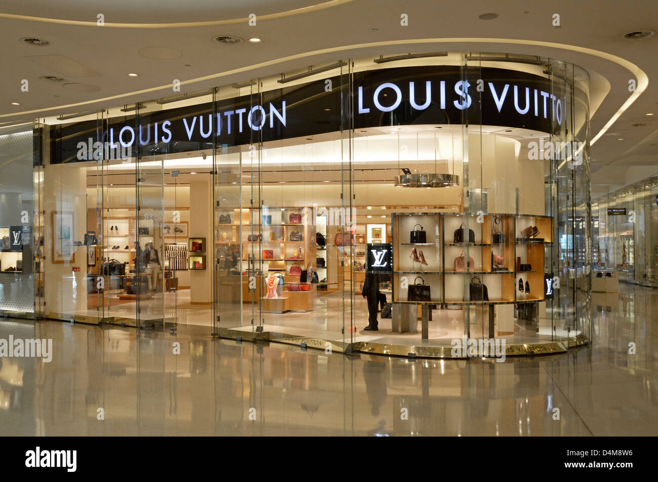 765c5538fe8 Louis Vuitton handbag store window shop front display in the Stock ...