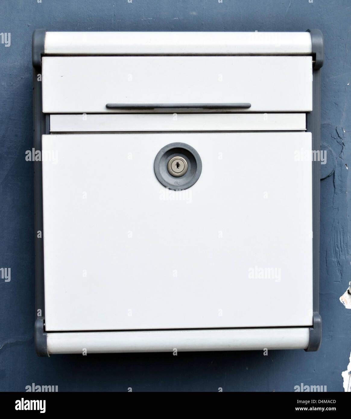 Post box hanging on wall - Stock Image
