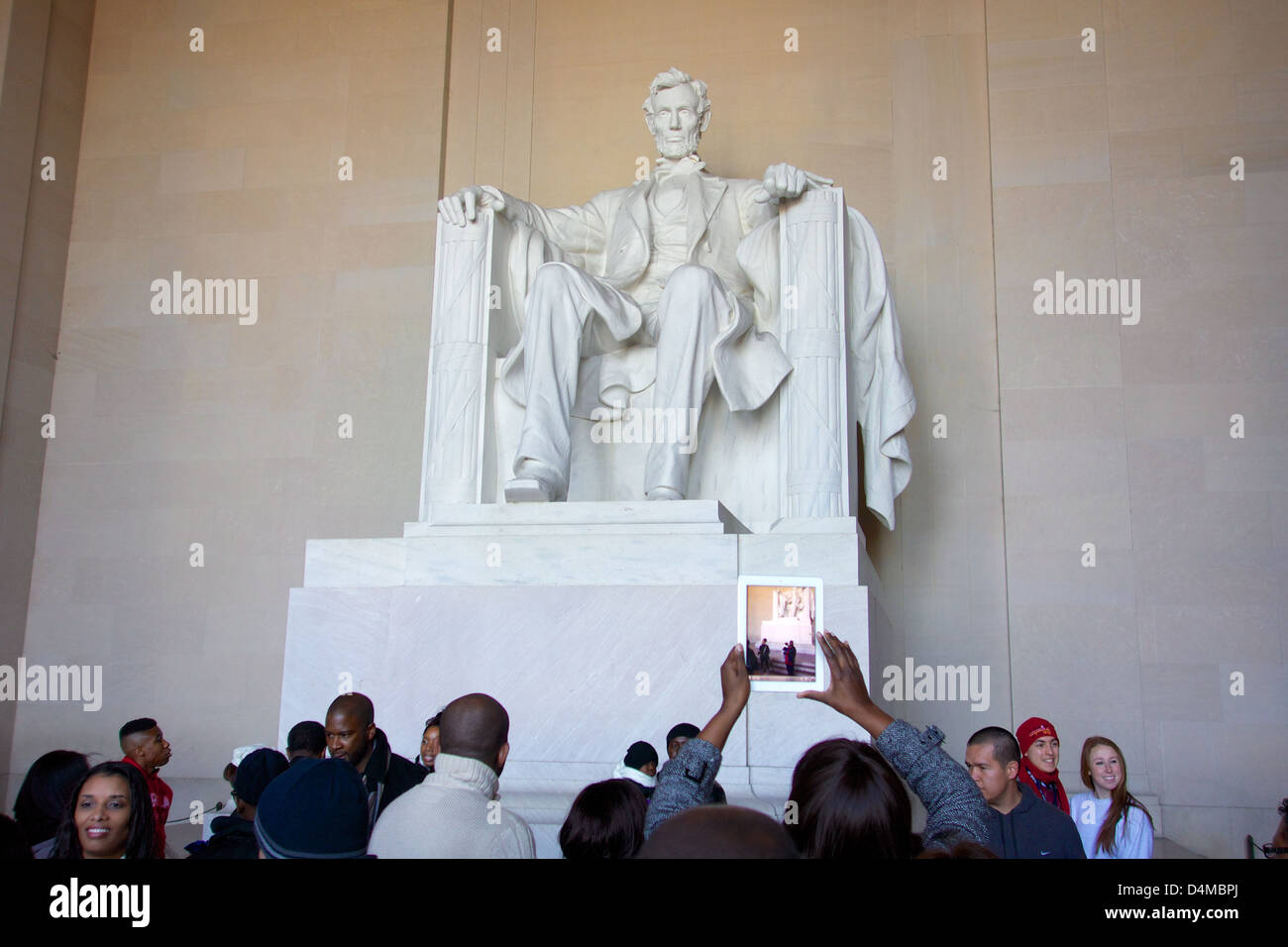 Lincoln Memorial with pre-inauguration crowd. Washington DC. Woman taking photo with iPad. Stock Photo