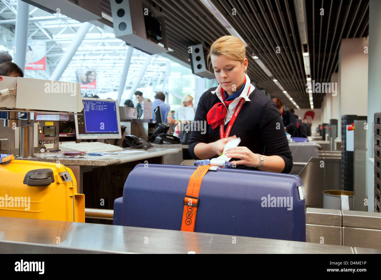 Duesseldorf, Germany, ground staff at airberlin check-in desk at the airport Duesseldorf International - Stock Image