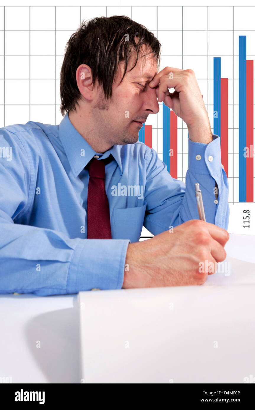 Mna with stress holding his head - Stock Image