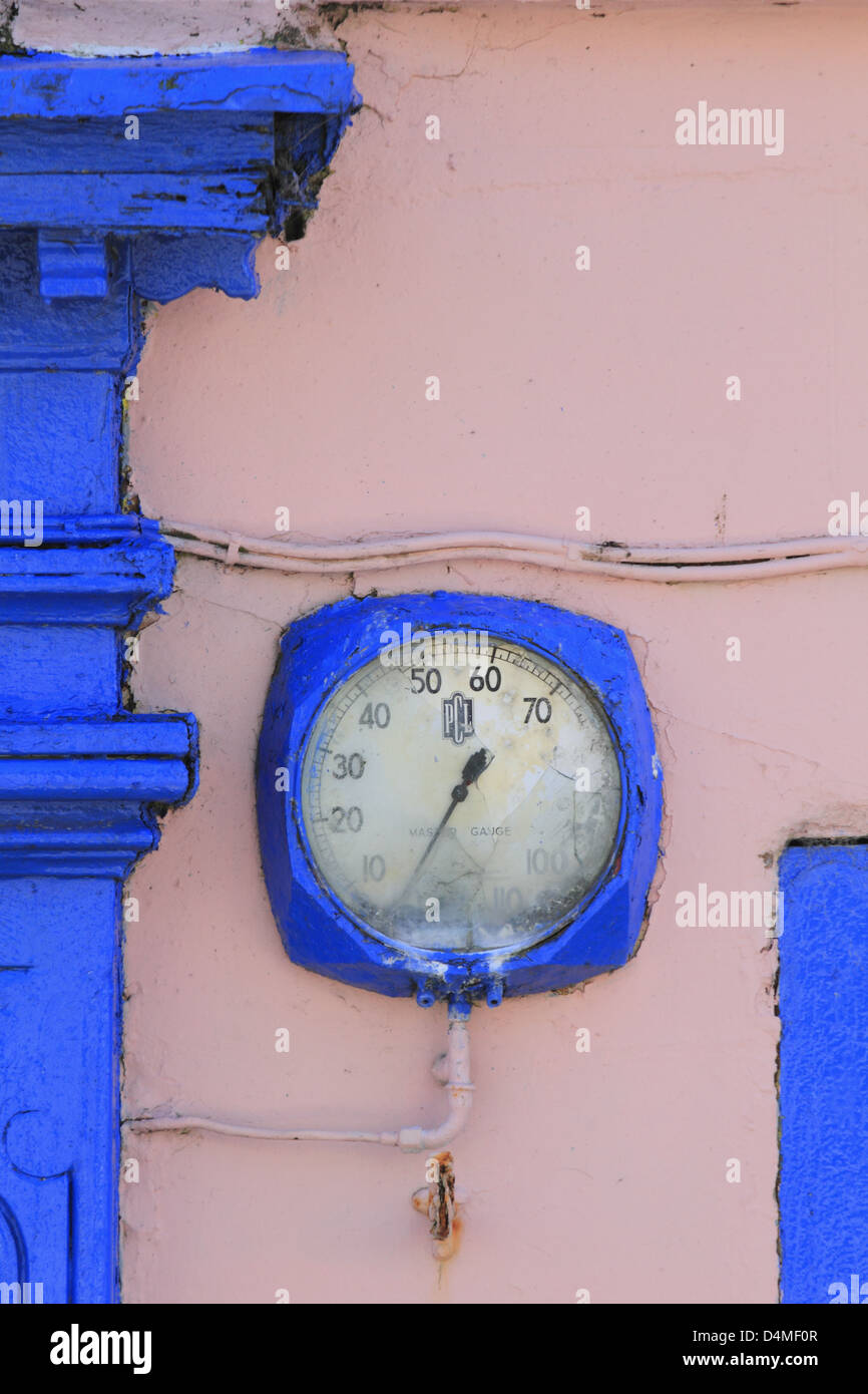 Old blue clock face on bright pink wall Schull Co County Cork west of Ireland - Stock Image